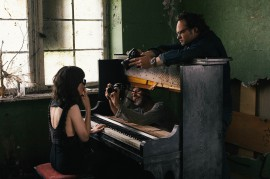 Daniel Gottschalk and Ralf Schmerberg shoot Meret Becker through a piano prepared for the film unique look.//Photography by Katja Oortman