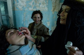 Veruschka tests her make up skill on Ewa Cerneva.//Photography by Ralf Schmerberg